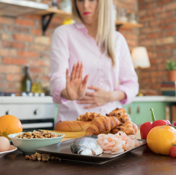 women holding hand to food saying no