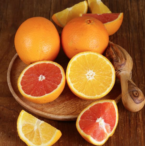oranges on cutting board