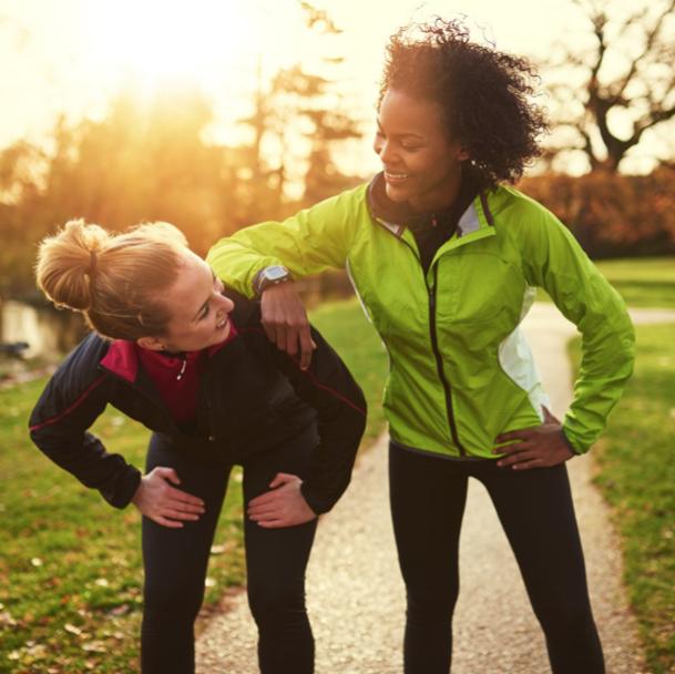two happy women on cardio jog