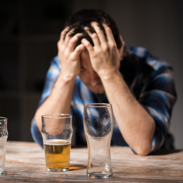 man feeling down about drinking beer