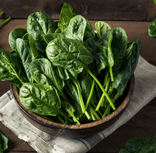 wooden bowl of raw spinach