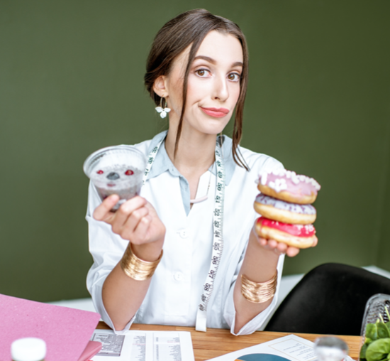 lady holding donuts