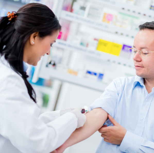 phlebotomist drawing blood from arm