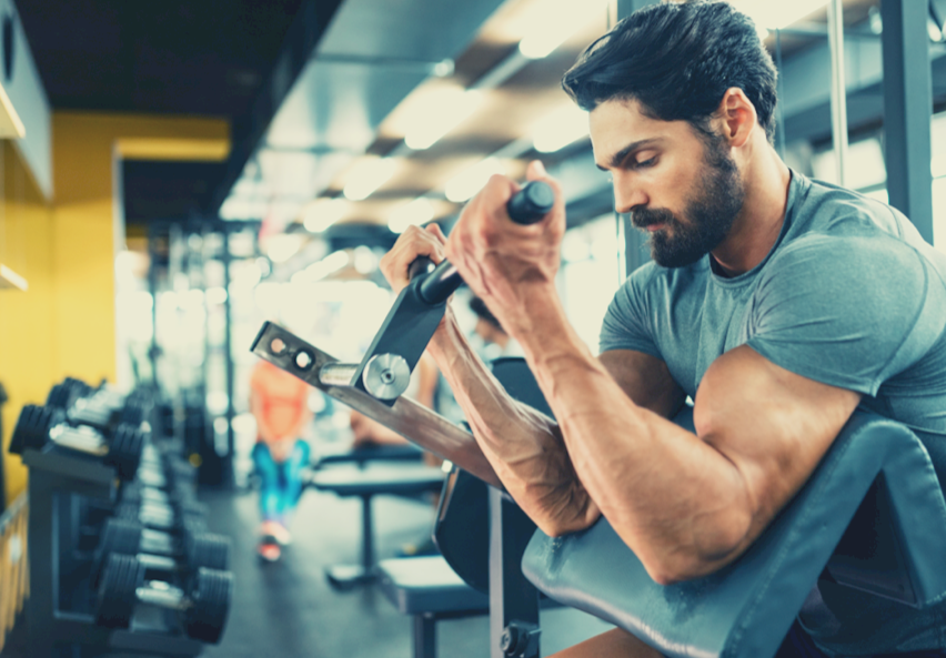 athletic man doing bicep curl