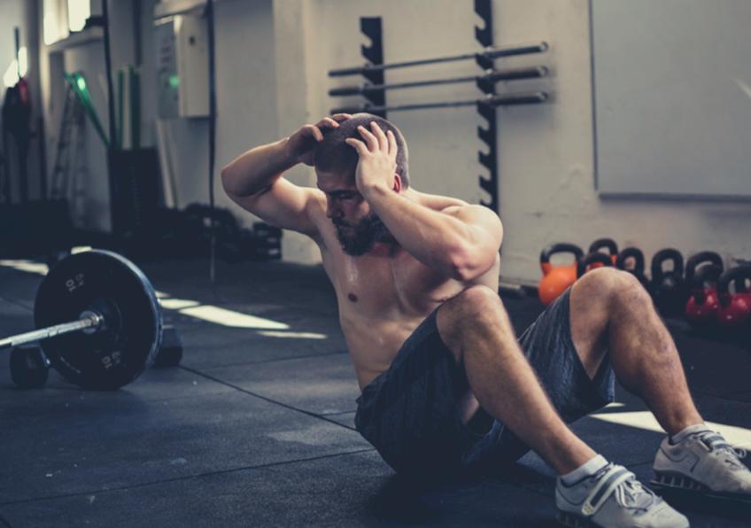 muscular man doing sit ups