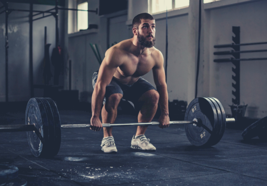 muscular man doing deadlift exercise