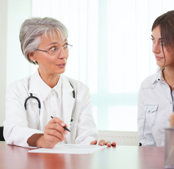 mature doctor accessing younger lady