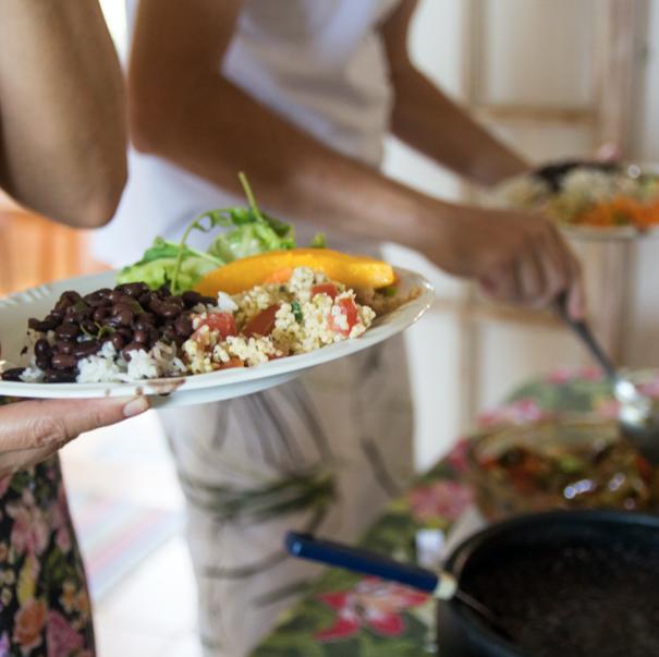 people serving vegan dishes