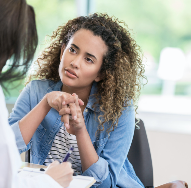young woman talking with doctor